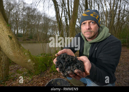 Phil Greenwood of Sacred Earth, Horam, East Sussex, with biochar - a natural soil enrichment that could help suppress ash dieback disease. - Stock Photo