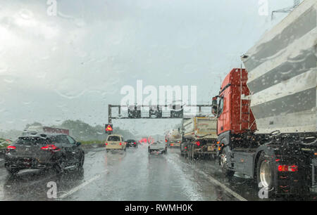heavy rain on german autobahn, mobile phone shot - Stock Photo