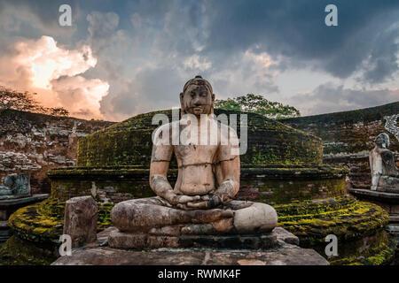 Meditating buddha statue in ancient city of Polonnaruwa, North Central Province, Sri Lanka - Stock Photo