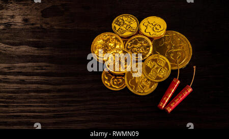 Chinese New Year chocolate lucky gold coins. Chinese words on coins translates - Fortune.