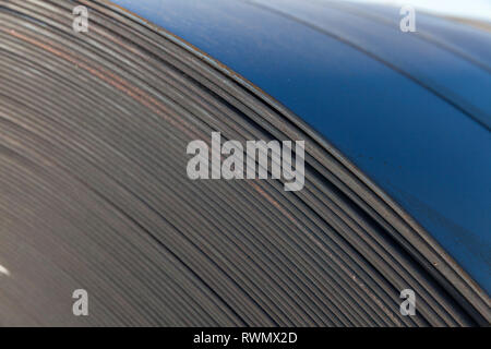 rolls of industrial sheet metal, manufacturing background - Stock Photo