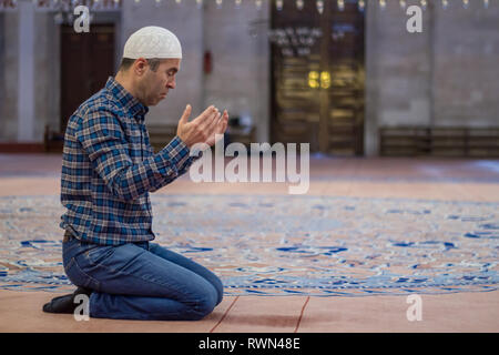 Muslim man to praying at the mosque - Stock Photo