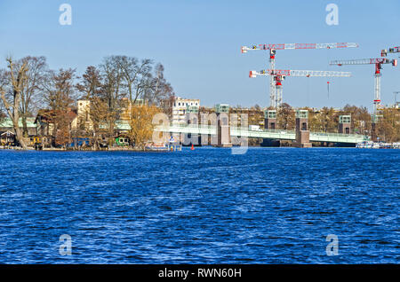 Berlin, Germany - February 22, 2019: Maselake bay of the River Havel with its steel girder bridge Spandauer-See Bruecke, the Island Kleiner Wall also  - Stock Photo