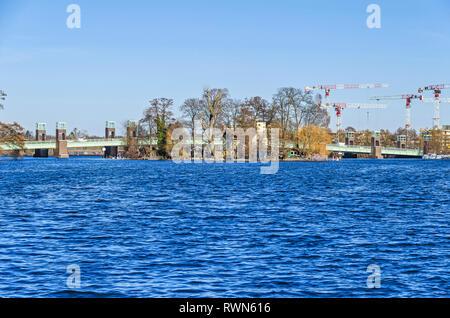 Berlin, Germany - February 22, 2019: Maselake bay of the River Havel with its steel girder bridge Spandauer-See Bruecke, the Island Kleiner Wall - Stock Photo