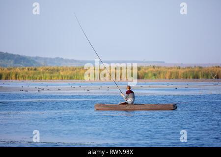 Unidentified fisherman on Danube. Romania - Stock Photo