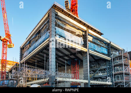 Skanska AB is a multinational construction of the shell and core of the new St Giles Circus Development building in Charing Cross Road, London - Stock Photo