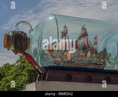 A monument depicting Lord Nelson's ship, HMS Victory, stands outside the National Maritime Museum in Greenwich, London, England. - Stock Photo
