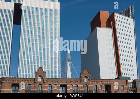 Rotterdam, Netherlands - March 26, 2016: Classical and modern architecture, on the left left De Rotterdam building by Rem Koolhaas, on the right KPN tower by Renzo Piano, Kop van Zuid and erasmus bridge in the middle - Stock Photo