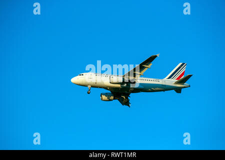 A Air France Airbus A319-111  plane lands at Heathrow Airport in West London. - Stock Photo