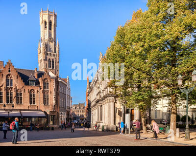 25 September 2018: Bruges, Belgium - Burg Square, looking towards the Market Square and the Belfry Tower on a sunny afternoon. - Stock Photo