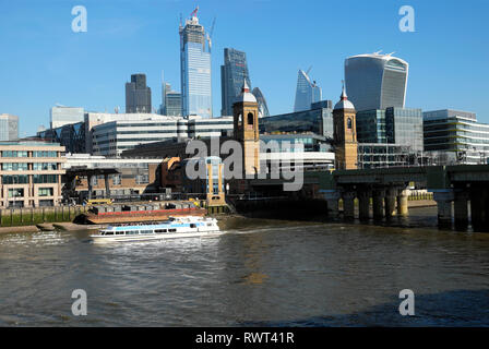 Tourist boat on the River Thames & view of Cannon Street Station & buildings in the City of London UK  KATHY DEWITT - Stock Photo