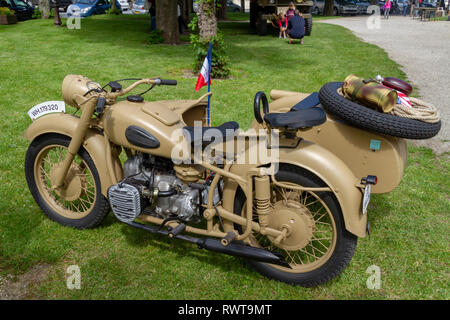 German World War Two motorcycle with sidecar (Bmw R75) in Sainte-Marie-du-Mont, Normandy, Manche, France, in June 2014. - Stock Photo