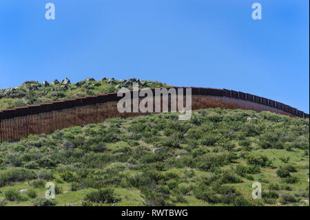 US border fence, pedestrian barrier, bollard type, Tecate, California, viewed from US side, uninhabited area east of Tecate Port of Entry, - Stock Photo