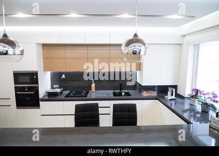 Dark brown modern kitchen interior - Stock Photo