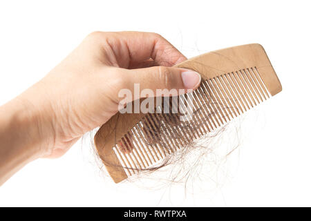 Human hand holding comb with lost hair on it, isolated on white background. - Stock Photo