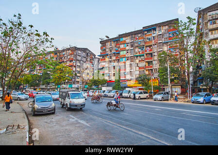 YANGON, MYANMAR - FEBRUARY 15, 2018: The shabby residential buildings in Botataung Pagoda road, on February 15 in Yangon. - Stock Photo