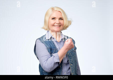 Beautiful lucky senior woman feeling excited and happy. she is happy that she finished her work. - Stock Photo