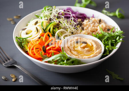 veggie couscous lunch bowl with spiralazed carrots and zucchini, hummus and red cabbage - Stock Photo