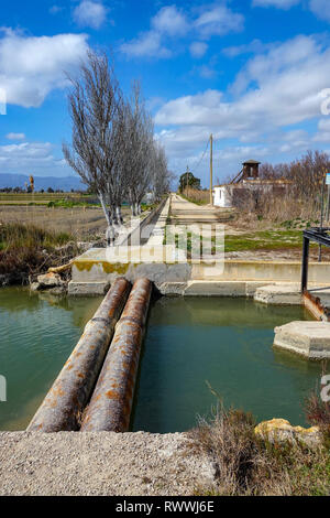 Pipes and irrigation ditches on The Ebro Delta nature reserve, near Amposta, Catalunya, Spain - Stock Photo