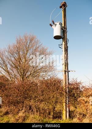 metal bucket hanging on pole electrics outside wires; essex; england; uk - Stock Photo