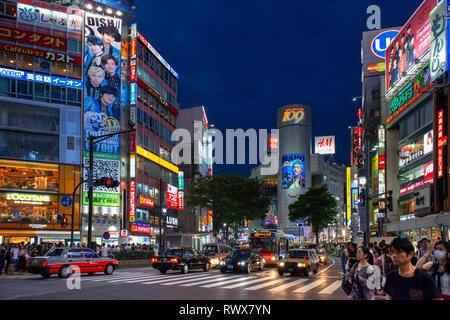 The shibuya district in Tokyo. Shibuya is popular district in Tokyo, for his pedestrian cross, Shibuya, Tokyo. Pedestrians cross Shibuya Crossing, one - Stock Photo
