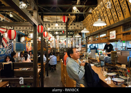 Restaurant in Hoppy Street or Hoppy Dori is the nickname of this alley in Asakusa outdoor izakaya spill out into the streets Tokyo Japan.  This 80-met - Stock Photo