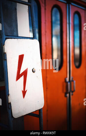 Close-up view on sign for electrical power on locomotive. - Stock Photo
