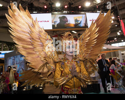 Berlin, Germany. 07th Mar, 2019. A dancer in a golden costume with wings at the stand of Indonesia Credit: Soeren Stache/dpa/Alamy Live News - Stock Photo