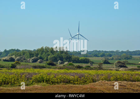 View of wind turbines on a hot day, from Kessingland Beach, Suffolk, UK - Stock Photo