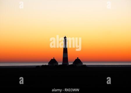 Lighthouse Westerheversand at sunset, Schleswig-Holstein Wadden Sea National Park, UNESCO World Heritage Site, Westerhever - Stock Photo