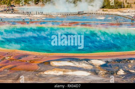 Tourists on a jetty in the thermal area, steaming hot springs, Grand Prismatic Spring, Midway Geyser Basin Stock Photo