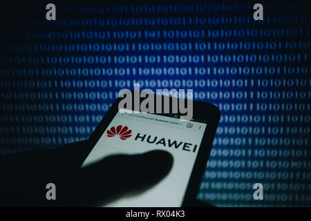 Huawei Logo On Its Website Is Shown On A Smartphone Display