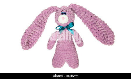 Toy pink bunny or hare with a bow on an isolated white background - Stock Photo