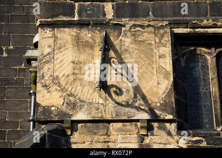 Sundial / Sun dial on the wall of Halifax Minster. Yorkshire. UK. Halifax Minster is dedicated to St John the Baptist. - Stock Photo