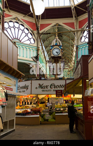 Central clock below the domed glass window and iron centre roof / ceiling  of Halifax indoor market, UK. (106) - Stock Photo