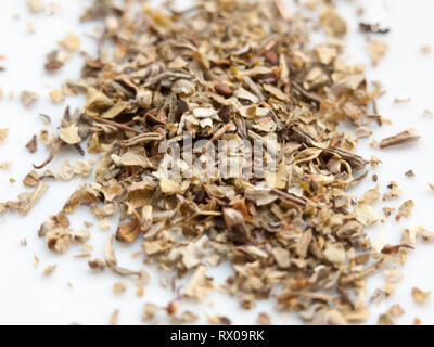 close up macro shot of mixed herbs on white background cooking food; essex; england; uk - Stock Photo