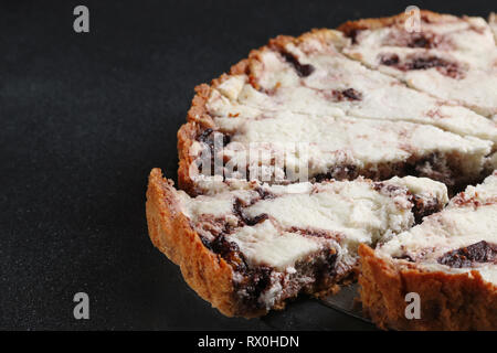 pie with ricotta and cheese close up on dark back - Stock Photo