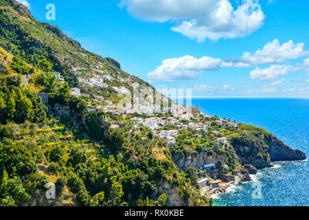 A view of a hilltop town Praiano, Italy from a scenic drive along the Amalfi Coast on the Italian Mediterranean - Stock Photo