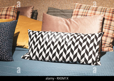 Luxury modern style bedroom and in gray, pink, brown and blue tones, Interior of a bedroom with plush cushions - Stock Photo