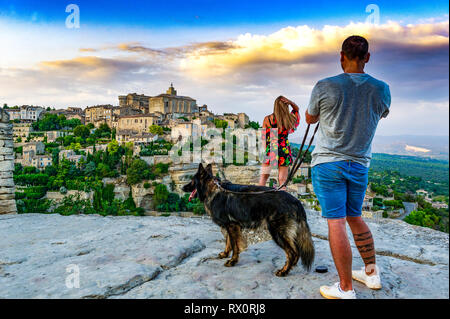 France. Vaucluse (84), Regional Natural Park of Luberon. The village of Gordes classified most beautiful village of France. Tourists taking pictures - Stock Photo