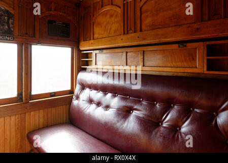 Art nouveau fittings and décor in a compartment of the Tambo Parlour Car, a first-class carriage built in 1919, Maldon railway station, Victoria, Aust - Stock Photo