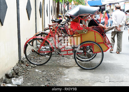 pedicab on traditional markets - Stock Photo