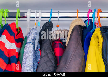 38b5a5374 Little boy's child size jackets, coats and sweaters hanging in a ...