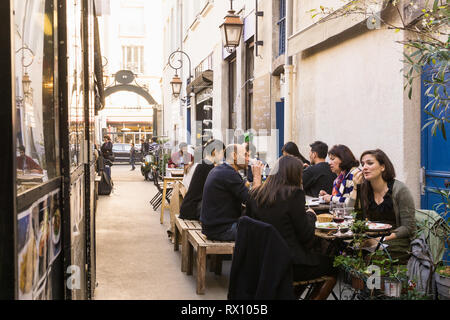 Paris food market - People having lunch break in eateries at the Marche des Enfants Rouges in the Marais district of Paris, France. - Stock Photo