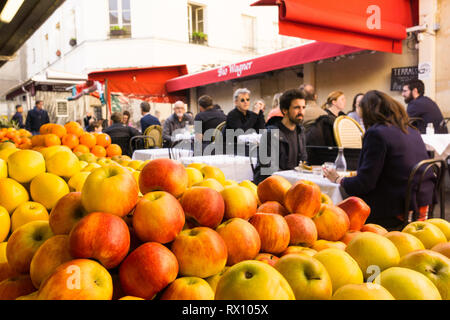 Paris food market - People having lunch break in eateries at the Marche des Enfants Rouges in the Marais district of Paris, France, Europe. - Stock Photo