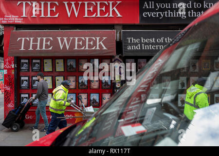 Workmen to and fro on the corner of Berwick and Broadwick Streets on 7th March 2019, in London, England. - Stock Photo