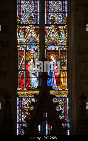 Saint Emilion, France - September 8, 2018: Annunciation - Stained glass window at the Collegiale church of Saint Emilion, France - Stock Photo