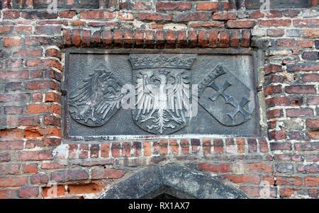 Historic emblems at Straganiarska Gate in Gdansk - Stock Photo