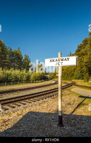 September 15, 2018 - Skagway, AK: Skagway Junction signpost along White Pass and Yukon Route rail line, next to The Dewey Creek walking path. - Stock Photo