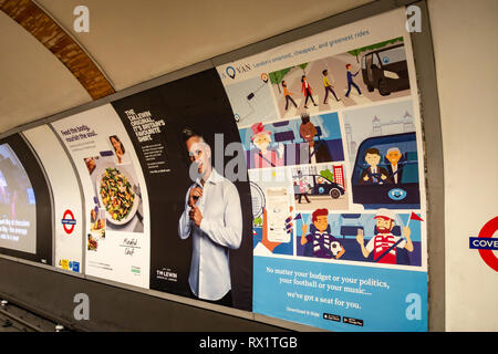 Billboard Advertising posters on the Underground Tube at Covent Garden, London - Stock Photo